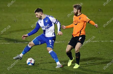 Max Ehmer of Bristol Rovers and Matty Taylor of Oxford United.