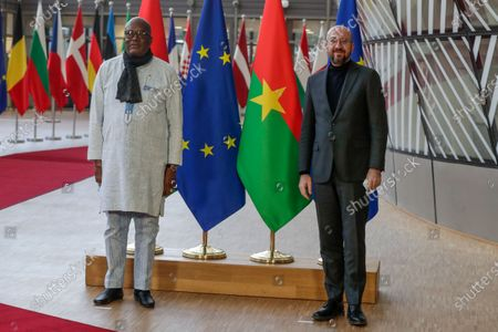 President of Burkina Faso Roch Marc Christian Kabore (L) is welcomed by European Council President Charles Michel (R) ahead of a meeting at the European Council in Brussels, Belgium, 09 February 2021.