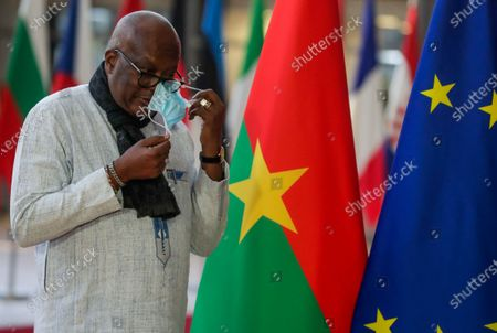 Stock Photo of President of Burkina Faso Roch Marc Christian Kabore arrives for a meeting with European Council President Charles Michel (not seen) at the European Council in Brussels, Belgium, 09 February 2021.