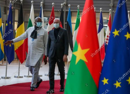 Stock Picture of President of Burkina Faso Roch Marc Christian Kabore (L) is welcomed by European Council President Charles Michel (R) ahead of a meeting at the European Council in Brussels, Belgium, 09 February 2021.