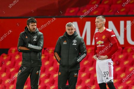 Ole Gunnar Solskjaer and Michael Carrick of Manchester United looks at Scott McTominay of Manchester United as he gets ready to come onto the field.