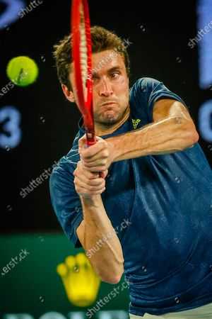 French Gilles Simon plays a backhand during a tennis match between French Simon and Greek Tsitsipas, in the first round of the men's singles competition of the 'Australian Open' tennis Grand Slam, Tuesday 09 February 2021 in Melbourne Park, Melbourne, Australia. The 2021 edition of the Australian Grand Slam has been delayed by three weeks because of the pandemic.
