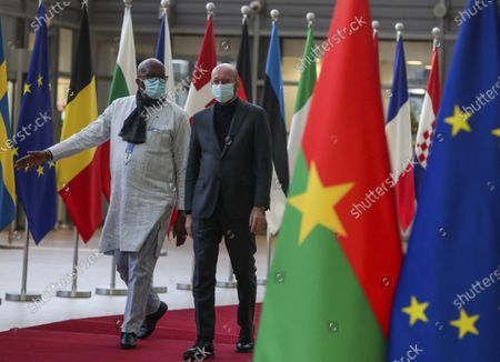 President of Burkina Faso, Roch Marc Christian Kabore, left, is welcomed by European Council President Charles Michel ahead of a meeting at the European Council building in Brussels