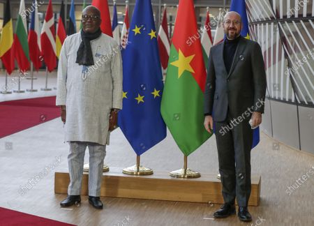Stock Image of President of Burkina Faso, Roch Marc Christian Kabore, left, is welcomed by European Council President Charles Michel ahead of a meeting at the European Council building in Brussels