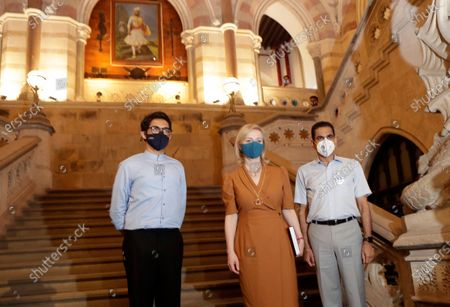 United Kingdom's Secretary of State for International Trade and Minister for Women and Equalities Elizabeth Truss, center, flanked by India's Maharashtra state Minister for Tourism and Environment Aditya Thackeray, left, and Brihanmumbai Municipal Corporation (BMC) Commissioner Iqbal Singh Chahal during her visit to iconic BMC headquarters in Mumbai, India