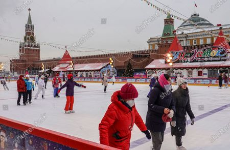 People enjoy cold weather skating at the GUM outdoor skating rink on the Red Square in Moscow, Russia, 09 February 2021. Restrictions have been eased in Moscow. The ban on work from 11 pm to 6 am in cafes, bars, clubs and karaoke and other entertainment venues is canceled. The requirement to transfer at least 30% of employees to telecommuting has also become a recommendation rather than a mandatory requirement. Museums, libraries and other cultural institutions were opened in the capital on January 22. And from February 08 they will leave distance learning to full-time. The main restrictions due to coronavirus can be removed in Moscow by May this announced Moscow Mayor Sergei Sobyanin.