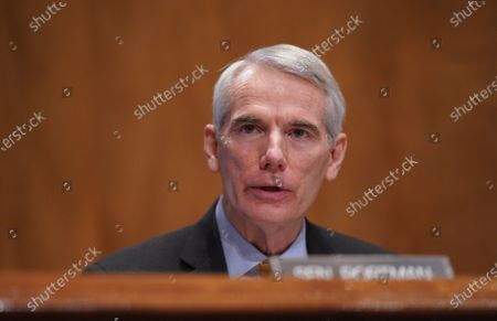 Ranking Member Robert Portman, R-Ohio, questions Neera Tanden during her testimony before the Senate Homeland Security and Government Affairs committee on her nomination to become the director of the Office of Management and Budget (OMB), during a hearing at the U.S. Capitol in Washington, DC on Tuesday, February 9, 2021. Tanden was nominated by President Joe Biden and is responsible for presenting the president's budget to congress.