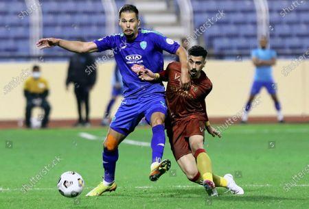 Al-Fateh's player Mitchell Te Vrede (L) in action against Al-Nassr's Ali Al-Oujami (R) during the Saudi Professional League soccer match between Al-Fateh and Al-Nassr at Prince Abdullah bin Jalawi Stadium, in Al-Hasa, Saudi Arabia, 09 February 2021.