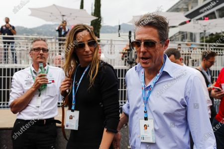 Stock Picture of MONTE CARLO, MONACO - MAY 27: Actor Hugh Grant arrives in the paddock with wife Anna Elisabet Bernstein during the Monaco GP at Monte Carlo on May 27, 2018 in Monte Carlo, Monaco. (Photo by Zak Mauger / LAT Images)