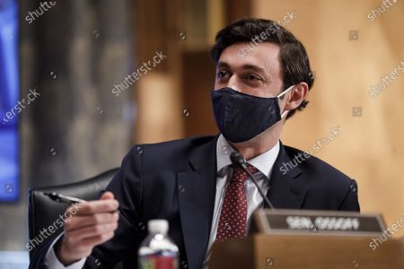 United States Senator Jon Ossoff (Democrat of Georgia), wears a protective mask while speaking during a Senate Homeland Security and Governmental Affairs Committee confirmation hearing for Neera Tanden, director of the Office and Management and Budget (OMB) nominee for U.S. President Joe Biden, in Washington, D.C., U.S.,. Tanden, who pledged to work with both parties after drawing sharp criticism from Republicans for sniping at them on social media, worked on the Affordable Care Act during the Obama years and was an aide to Hillary Clinton from her time as first lady.