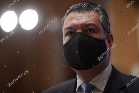 Stock Photo of United States Senator Alex Padilla (Democrat of California) , wears a protective mask during a Senate Homeland Security and Governmental Affairs Committee confirmation hearing for Neera Tanden, director of the Office and Management and Budget (OMB) nominee for U.S. President Joe Biden, in Washington, D.C., U.S.,. Tanden, who pledged to work with both parties after drawing sharp criticism from Republicans for sniping at them on social media, worked on the Affordable Care Act during the Obama years and was an aide to Hillary Clinton from her time as first lady.