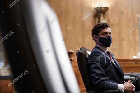 United States Senator Jon Ossoff (Democrat of Georgia), wearing a protective mask, during a Senate Homeland Security and Governmental Affairs Committee confirmation hearing for Neera Tanden, director of the Office and Management and Budget (OMB) nominee for U.S. President Joe Biden, in Washington, D.C., U.S.,. Tanden, who pledged to work with both parties after drawing sharp criticism from Republicans for sniping at them on social media, worked on the Affordable Care Act during the Obama years and was an aide to Hillary Clinton from her time as first lady.