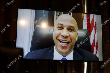 United States Senator Cory Booker (Democrat of New Jersey), appears on a screen remotely during a Senate Homeland Security and Governmental Affairs Committee confirmation hearing for Neera Tanden, director of the Office and Management and Budget (OMB) nominee for U.S. President Joe Biden, in Washington, D.C., U.S.,. Tanden, who pledged to work with both parties after drawing sharp criticism from Republicans for sniping at them on social media, worked on the Affordable Care Act during the Obama years and was an aide to Hillary Clinton from her time as first lady.