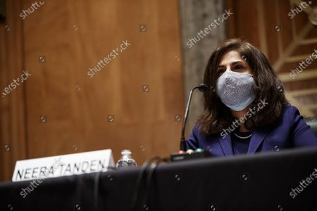 Neera Tanden, director of the Office and Management and Budget (OMB) nominee for U.S. President Joe Biden, wearing a protective mask during a Senate Homeland Security and Governmental Affairs Committee confirmation hearing in Washington, D.C., U.S.,. Tanden, who pledged to work with both parties after drawing sharp criticism from Republicans for sniping at them on social media, worked on the Affordable Care Act during the Obama years and was an aide to Hillary Clinton from her time as first lady.