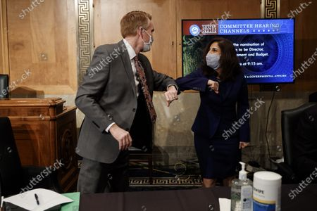 Neera Tanden, director of the Office and Management and Budget (OMB) nominee for U.S. President Joe Biden, greets United States Senator James Lankford (Republican of Oklahoma), during a Senate Homeland Security and Governmental Affairs Committee confirmation hearing in Washington, D.C., U.S.,. Tanden, who pledged to work with both parties after drawing sharp criticism from Republicans for sniping at them on social media, worked on the Affordable Care Act during the Obama years and was an aide to Hillary Clinton from her time as first lady.