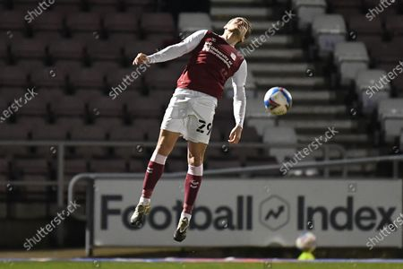 Northampton Town forward Danny Rose (29) heads the ball during the EFL Sky Bet League 1 match between Northampton Town and Wigan Athletic at the PTS Academy Stadium, Northampton