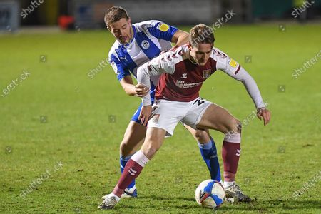 Northampton Town forward Danny Rose (29) battles for possession  with Wigan Athletic defender (on loan from Plymouth Argyle) Scott Wooten (14) during the EFL Sky Bet League 1 match between Northampton Town and Wigan Athletic at the PTS Academy Stadium, Northampton