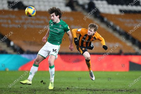 Hull City's Keane Lewis Potter, Lincoln City's Joe Walsh during the EFL Sky Bet League 1 match between Hull City and Lincoln City at the KCOM Stadium, Kingston upon Hull