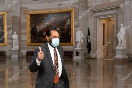 Stock Photo of Rep. Al Green, D-Texas, gives thumbs up as he walks through the Rotunda to the Senate for the second impeachment trial of former President Donald Trump, in Washington