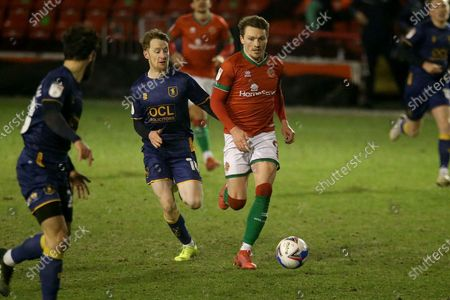 Walsall's Caolan Lavery Mansfield Town's George Maris during the EFL Sky Bet League 2 match between Walsall and Mansfield Town at the Banks's Stadium, Walsall