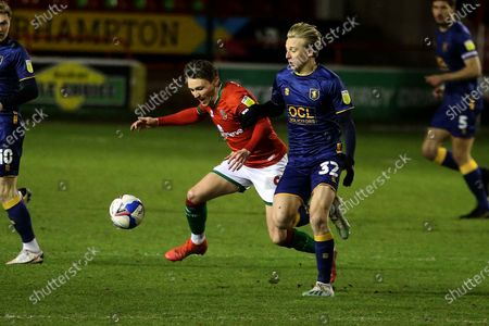 Walsall's Caolan Lavery Mansfield Town's George Lapslie during the EFL Sky Bet League 2 match between Walsall and Mansfield Town at the Banks's Stadium, Walsall