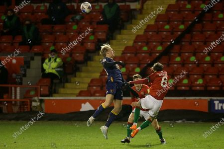 Walsall's Liam Kinsella Mansfield Town's George Lapslie during the EFL Sky Bet League 2 match between Walsall and Mansfield Town at the Banks's Stadium, Walsall