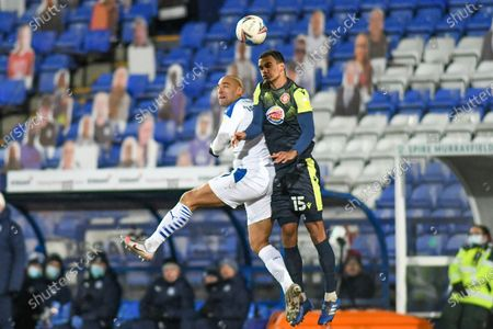 Tranmere Rovers striker James Vaughan (9) and Stevenage defender Terence Vancooten (15) challenge for the ball during the EFL Sky Bet League 2 match between Tranmere Rovers and Stevenage at Prenton Park, Birkenhead
