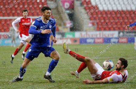 Stock Image of Kieffer Moore of Cardiff runs over Clark Robertson of Rotherham United