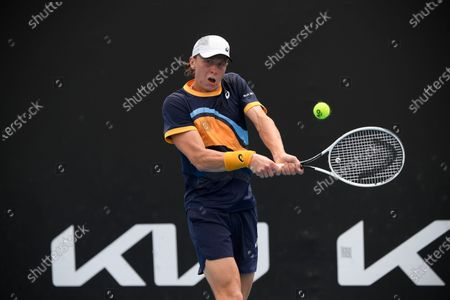 Finland's Emil Ruusuvuori makes a backhand return to France's Gael Monfils during their first round match at the Australian Open tennis championship in Melbourne, Australia