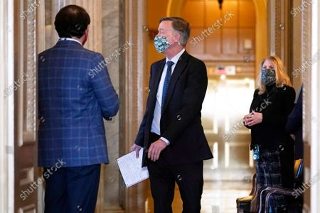 Sen. John Hickenlooper, D-Colo., arrives for the second impeachment trial of former President Donald Trump in the Senate, at the Capitol in Washington,.