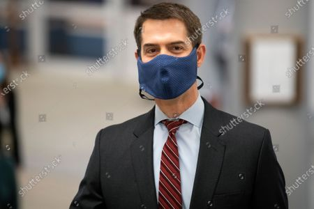 "Stock Photo of UNITED STATES - February 9: Sen. Tom Cotton, R-Ark., walks through the Senate subway on the first day of former President Donald Trump's second impeachment trial at the U.S. Capitol in Washington. Trump is charged with ""incitement of insurrection"" after his supporters stormed the Capitol in an attempt to overturn November's election result. (Photo by Caroline Brehman/CQ Roll Call)"