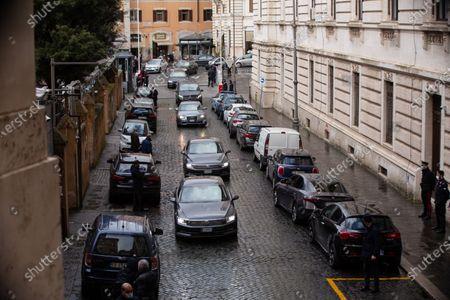 Silvio Berlusconi approaches the Montecitorio entrance in his car