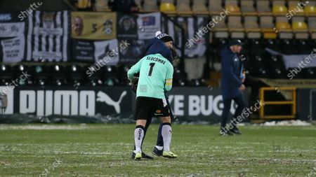 A hug from boss Neal Ardley at full time to stand in goalkeeper Michael Doyle following his near perfect performance in net for Notts.
