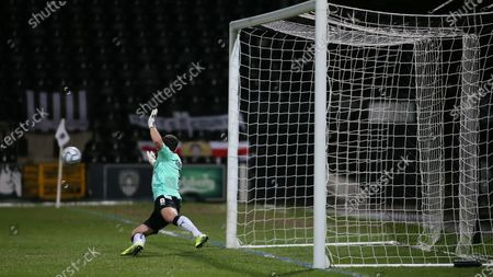 Make shift goalie Michael Doyle watches on as the resulting penalty crashes back off the post.