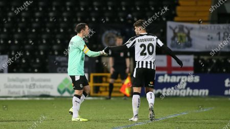 Michael Doyle fist bumps team mate Ruben Rodrigues at full time following a successful win.