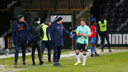 Michael Doyle prepares for his stint in goal as the gaffer Neal Ardley gives him some final words of advice.