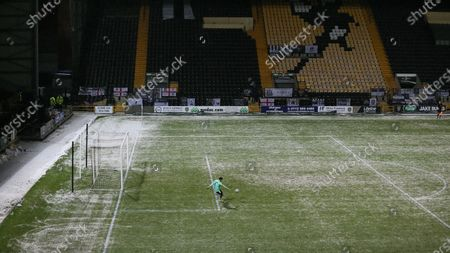 Stock Image of Michael Doyle takes a goalkick during a snowy match at Meadow Lane.
