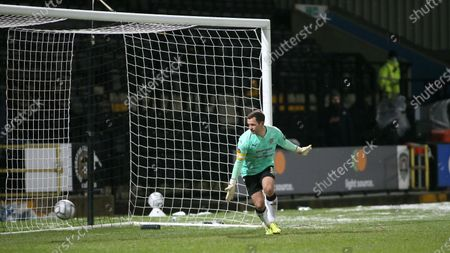 Stock Photo of Michael Doyle watches the ball roll past him into the back of the net as Notts' clean sheet goes out the window.