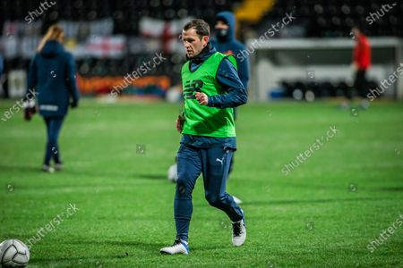 Stock Picture of Skipper Michael Doyle warms up for the Magpies.