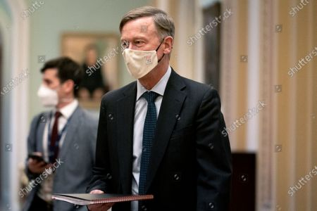Senator John Hickenlooper, a Democrat from Colorado, wears a protective mask while walking through the U.S. Capitol in Washington, D.C., U.S.,. The Senate begins Donald Trump's second impeachment trial today with a fight over whether the proceeding is constitutional, as a number of conservative lawyers reject the defense team's claim that a former president can't be convicted of a crime by Congress.