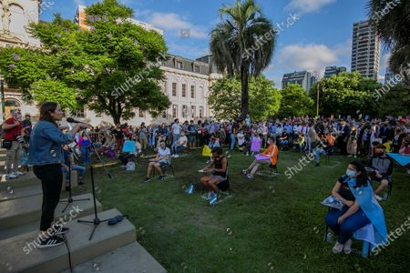Supporters of former President Mauricio Macri and citizens in general take part in a day of open classes in front of the Ministry of Education, to demand the return of classroom education throughout the country amid the pandemic, in Buenos Aires, Argentina, 09 February 2021. Juntos por el Cambio, an Argentine political coalition led by Mauricio Macri, promotes on 09 February a national day of open classes to accompany students, teachers, parents and mothers who ask that the face-to-face modality be resumed throughout the country in the school year.