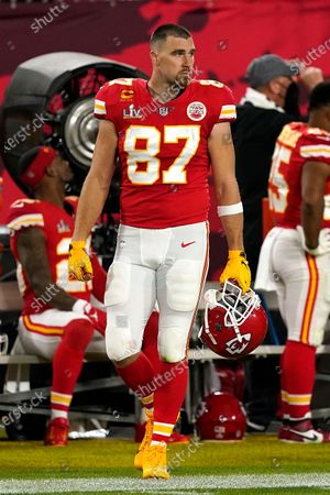 Kansas City Chiefs tight end Travis Kelce (87) watches from the sideline during the first half of the NFL Super Bowl 55 football game against the Tampa Bay Buccaneers, in Tampa, Fla. The Tampa Bay Buccaneers defeated the Kansas City Chiefs 31-9