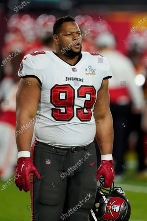 Tampa Bay Buccaneers defensive end Ndamukong Suh (93) walks toward the sideline during the first half of the NFL Super Bowl 55 football game against the Kansas City Chiefs, in Tampa, Fla. The Tampa Bay Buccaneers defeated the Kansas City Chiefs 31-9