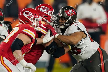 Tampa Bay Buccaneers defensive end Ndamukong Suh (93) battles against Kansas City Chiefs offensive guard Stefen Wisniewski (61) during the second half of the NFL Super Bowl 55 football game, in Tampa, Fla. The Tampa Bay Buccaneers defeated the Kansas City Chiefs 31-9