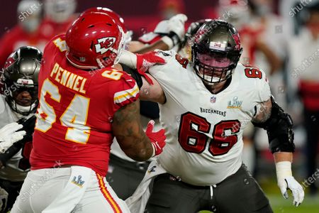 Tampa Bay Buccaneers center Ryan Jensen (66) battles against Kansas City Chiefs defensive tackle Mike Pennel (64) during the second half of the NFL Super Bowl 55 football game, in Tampa, Fla. The Tampa Bay Buccaneers defeated the Kansas City Chiefs 31-9