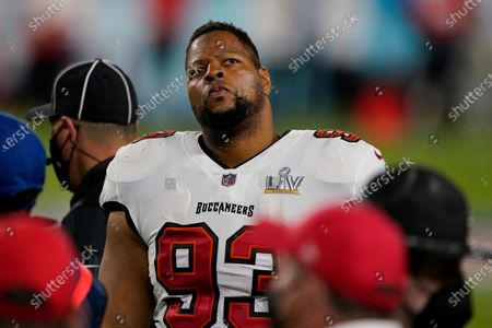 Tampa Bay Buccaneers defensive end Ndamukong Suh (93) looks out towards the crowd during the second half of the NFL Super Bowl 55 football game against the Kansas City Chiefs, in Tampa, Fla. The Tampa Bay Buccaneers defeated the Kansas City Chiefs 31-9