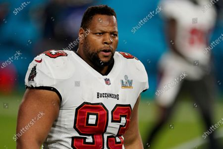 Tampa Bay Buccaneers defensive end Ndamukong Suh (93) walks toward the sideline during the second half of the NFL Super Bowl 55 football game against the Kansas City Chiefs, in Tampa, Fla. The Tampa Bay Buccaneers defeated the Kansas City Chiefs 31-9