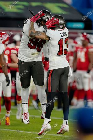Tampa Bay Buccaneers nose tackle Steve McLendon (96) and Tampa Bay Buccaneers wide receiver Mike Evans (13) react after a play during the second half of the NFL Super Bowl 55 football game against the Kansas City Chiefs, in Tampa, Fla. The Tampa Bay Buccaneers defeated the Kansas City Chiefs 31-9