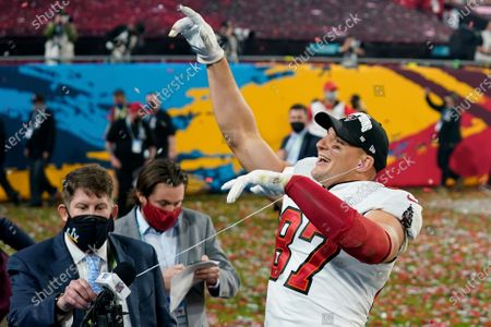 Tampa Bay Buccaneers tight end Rob Gronkowski (87) points out to the crowd during an interview after the NFL Super Bowl 55 football game against the Kansas City Chiefs, in Tampa, Fla. The Tampa Bay Buccaneers defeated the Kansas City Chiefs 31-9