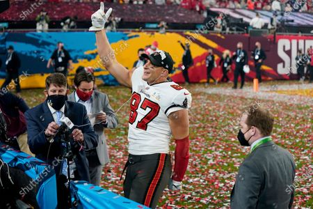 Tampa Bay Buccaneers tight end Rob Gronkowski (87) gestures to the crowd during an interview after the NFL Super Bowl 55 football game against the Kansas City Chiefs, in Tampa, Fla. The Tampa Bay Buccaneers defeated the Kansas City Chiefs 31-9